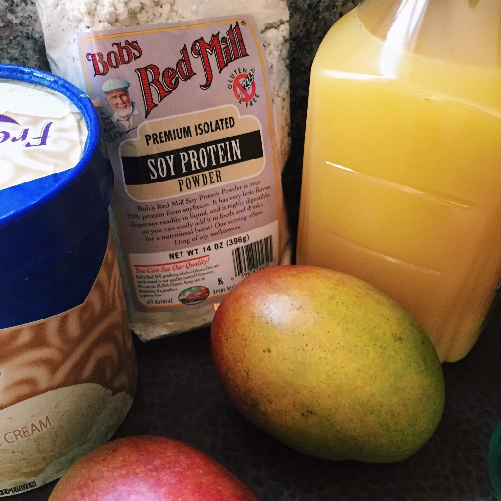 Protein Packed Mango Smoothie Ingredients: Bob's Red Mill Soy Protein Powder, OJ, Mango, Vanilla Ice Cream