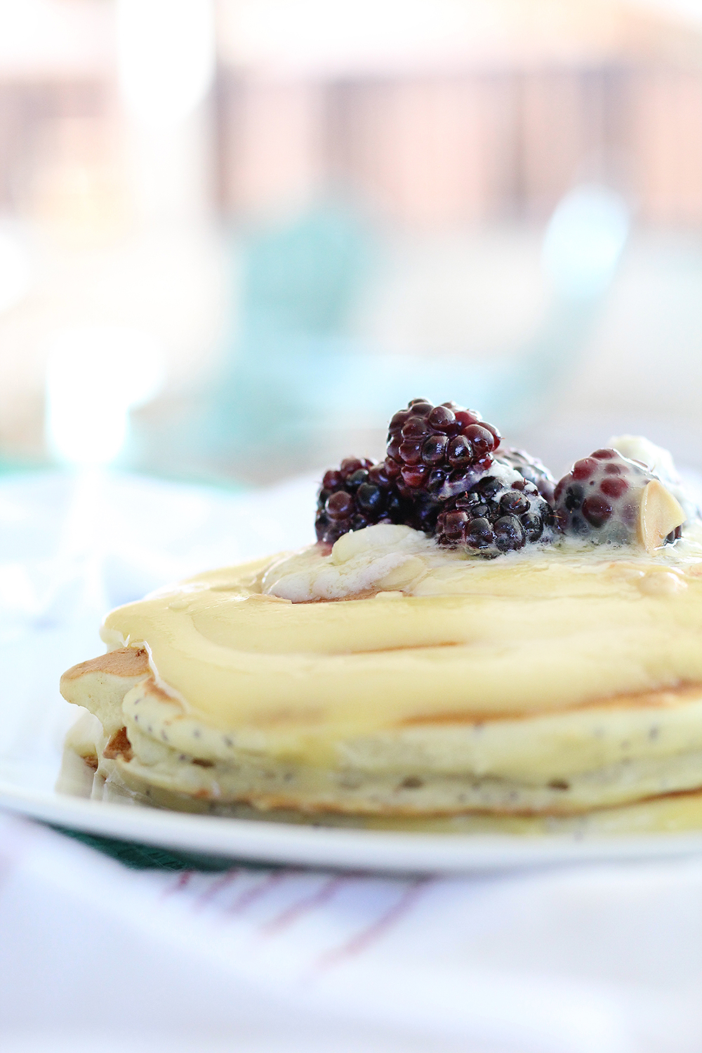 The Starburst Pancakes from Snooze are made from lemon buttermilk poppyseed batter then topped with a homemade lemon anglaise, macerated blackberries, ...