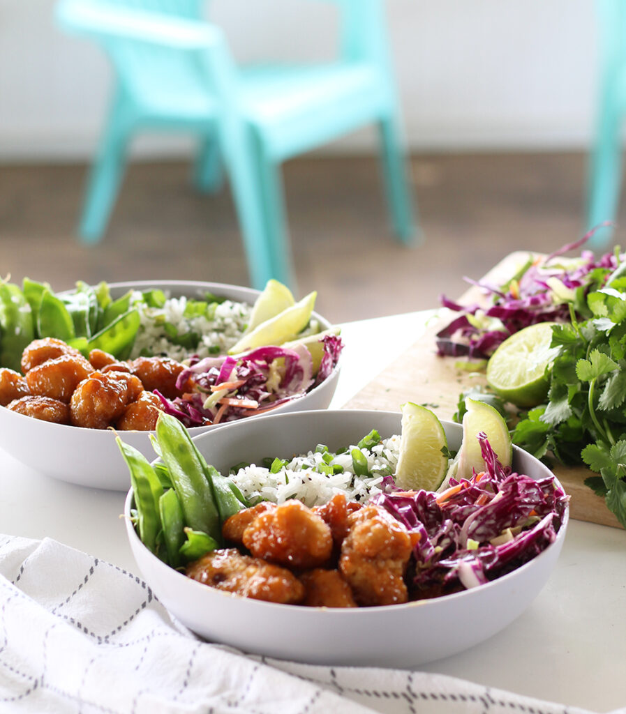 orange chicken bowls with coleslaw